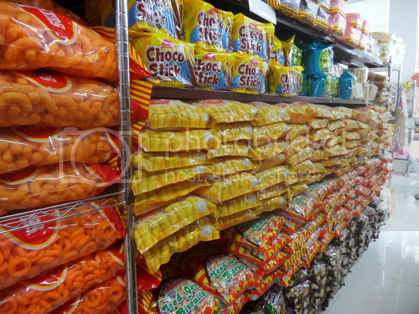 Cookie sticks and bags of cheese curls and cheese rings on sale.