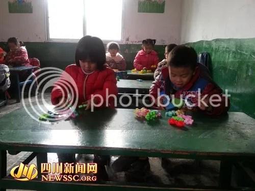 Wang Xin-Yin (girl) and Wang Yue-Long (boy)