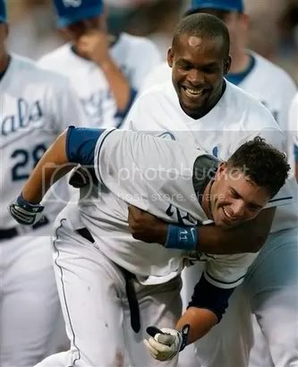 DeJesus and Jose Guillen celebrate the victory.