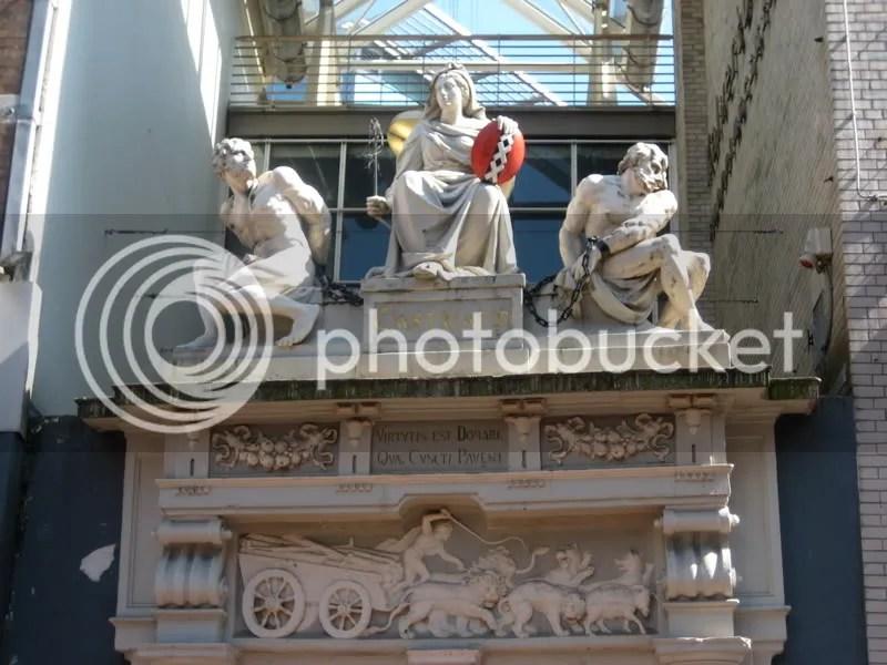 Castigato, over the entrance to a shopping centre