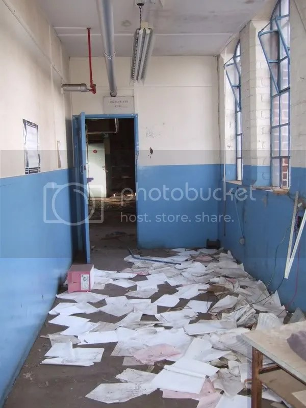 Another corridor of papers that were strewn about the floor. Pictures, Images and Photos