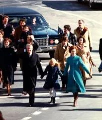 Carter family walking to the inauguration