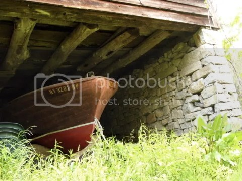 Boat under barn