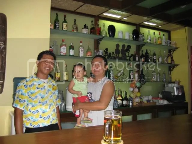 Leo, the bartender allowed us to enter his work area and pose with him. Thats my Php 90 beer, by the way.