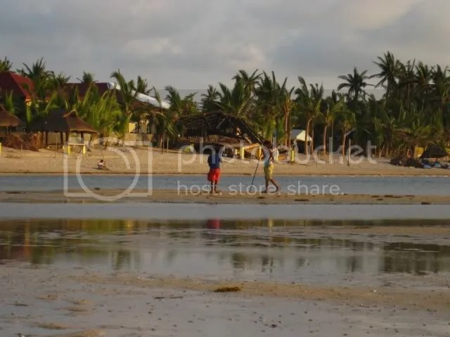 This is how shallow the beach water is. I took this shot from more than 100 meters from the beach. That tiny speck near the hut on the left are my wife and son.