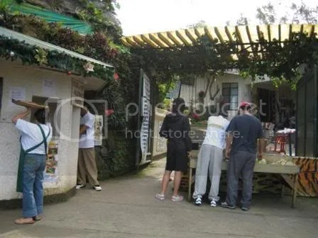 Inns entrance. The people shown here are picking free foods for the animals and birds.