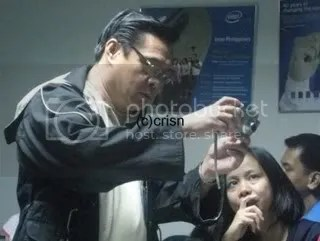 Mr. Benjie Rivera showing a student the point-and-shoot useful features.