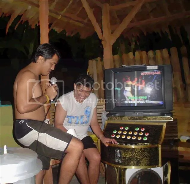 Alcohol and videoke does mix. At least if done in resorts...and if this picture doesnt get through your wifes facebook.