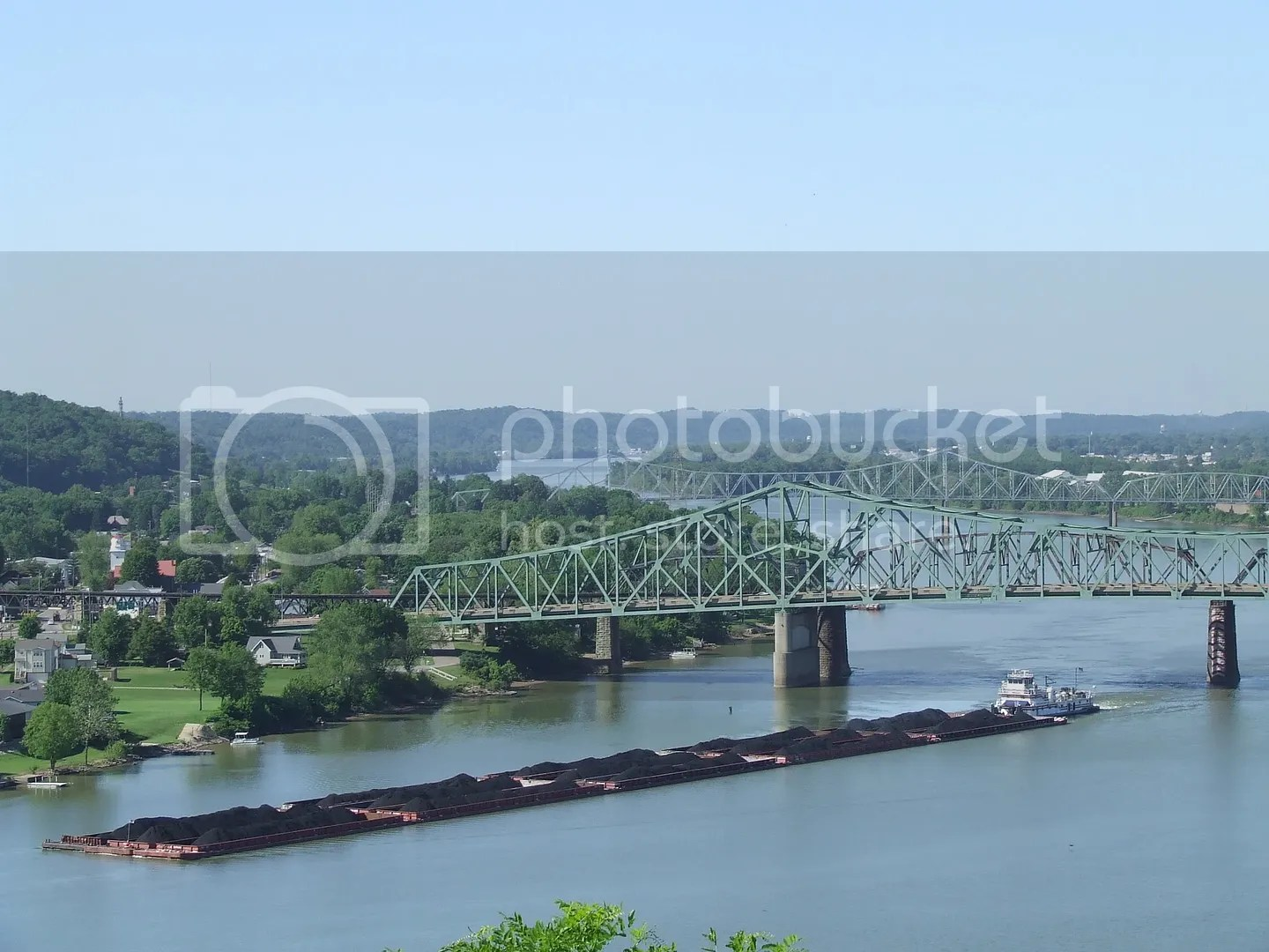 A barge hauling coal makes its way down the Ohio river at Parkersburg, WV