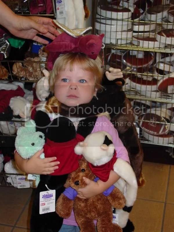 Playing with the stuffed animals at the MSC Bookstore...Aidan doesn't look thrilled does she?