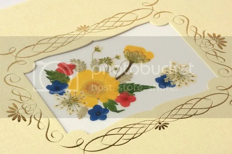 telegram dengan hiasan bunga kering