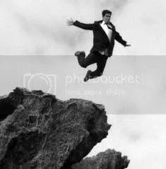 man leaping off of cliff image