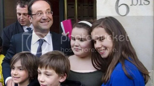 Newly elected president Francois Hollande poses with children in front of his home on May 7, 2012 in Paris, one day after the announcement of the first official results of the French presidential second round.  Flora Hollande Daughter Thomas Hollande Son Julien Hollande Son Clémence Hollande Son