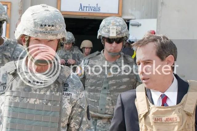 Stuart E. Jones, U.S. ambassador to Iraq, greets U.S. Army Gen. Martin E. Dempsey, chairman of the Joint Chiefs of Staff, as he arrives in Baghdad, Nov. 15, 2014.