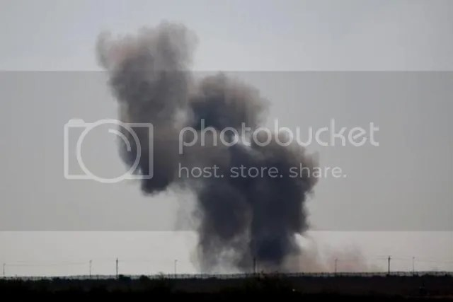 Smoke rises following an explosion in Egypt's northern Sinai Peninsula, as seen from the Israel-Egypt border, near Kerem Shalom town, southern Israel, Wednesday, July 1, 2015.