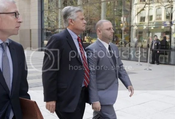 New York Senate Majority Leader Dean Skelos, center, and his son Adam, right, arrive at FBI offices, Monday, May 4, 2015, in New York. The pair surrendered to face charges including extortion and soliciting bribes amid a federal investigation into the awarding of a $12 million contract to a company that hired his son