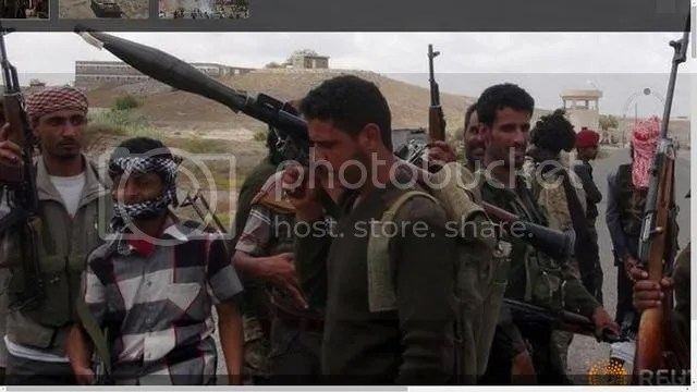 Southern People's Resistance militants gather at the Al-Anad air base in Lahej, March 22 2015.   President Hadi: Backed by military and police loyalists, and by militia known as Popular Resistance Committees, he is trying to fight back against the rebels