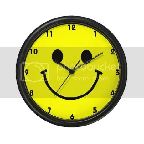 yellow Smiley Face Wall Clock on CafePress