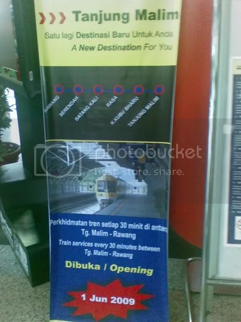 Poster advertising new KTM Komuter service extension to Tanjung Malim