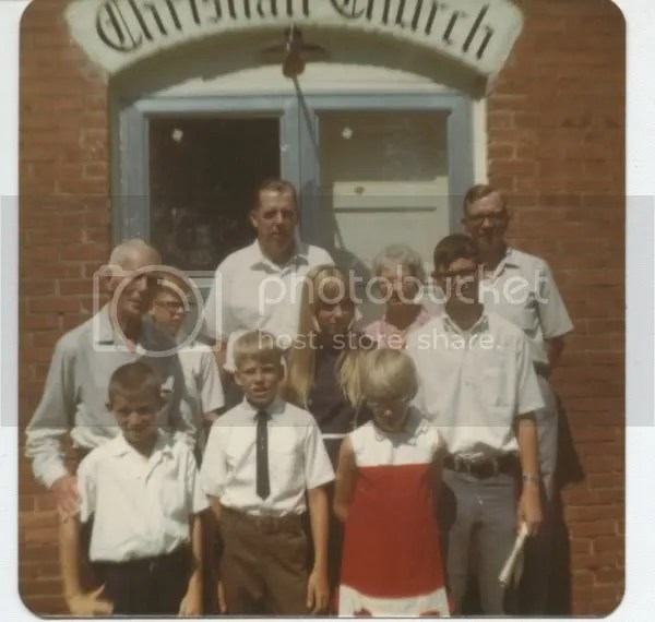 Colley family in front of Lowry City Christian Church.  Earls father Alvin is in the picture, as well as Earls brother Gene, Genes wife Mary, and assorted children of Earl and Gene.