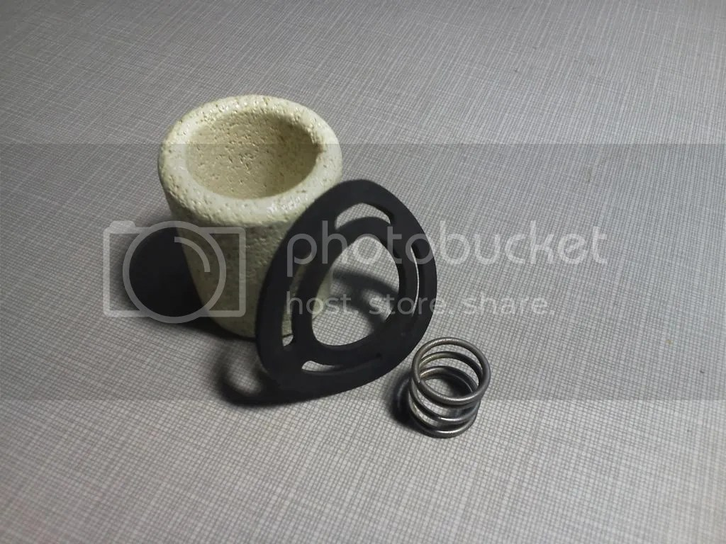 hight resolution of the glass bowl filter is serviced annually by disassembling and back flushing the ceramic element and if necessary replacing the gasket and spring