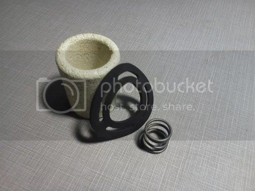 small resolution of the glass bowl filter is serviced annually by disassembling and back flushing the ceramic element and if necessary replacing the gasket and spring