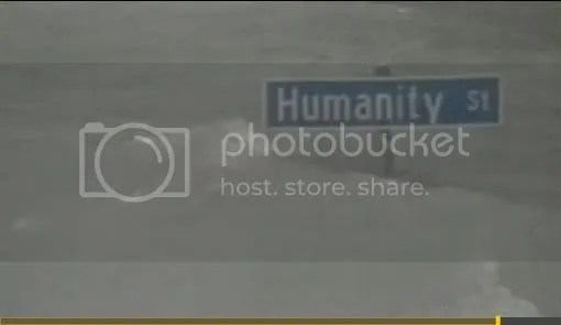 Picture of Humanity St sign poking up above floodwater
