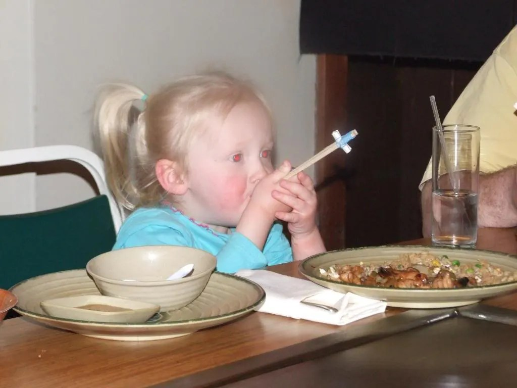 Cecelia tries out the chopsticks.