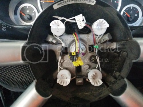 small resolution of not the horn button on the steering wheel the harness behind the airbag had four separate buttons or switches