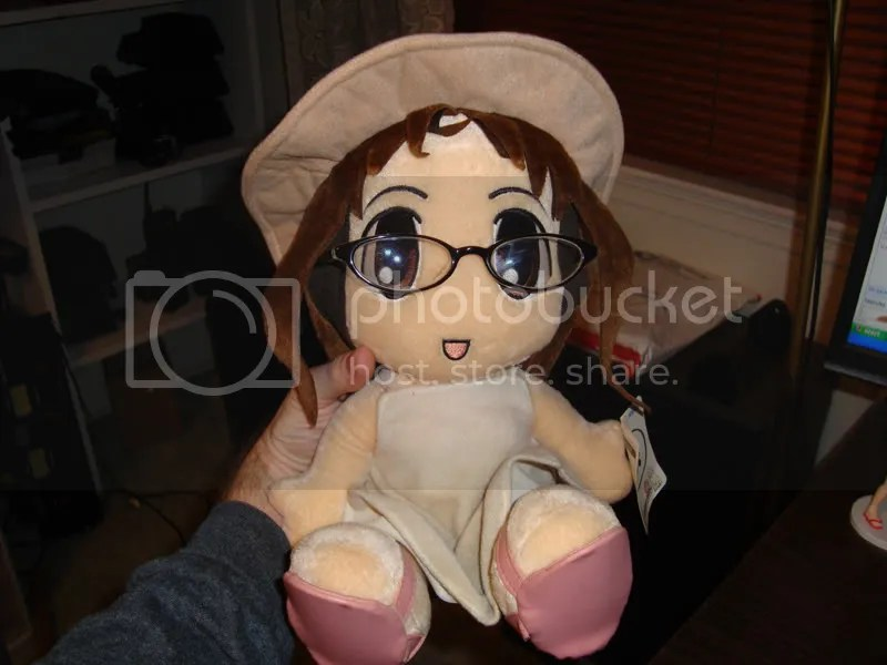 Osaka doll with glasses