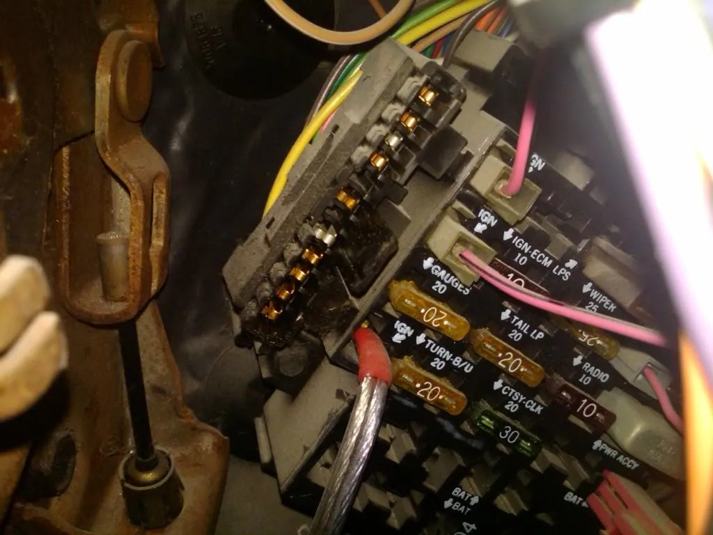 hight resolution of the reciever pin on the fuse box has a light blue wire going to it from the brake light switch on the pedal but the 85 and prior switch is different then