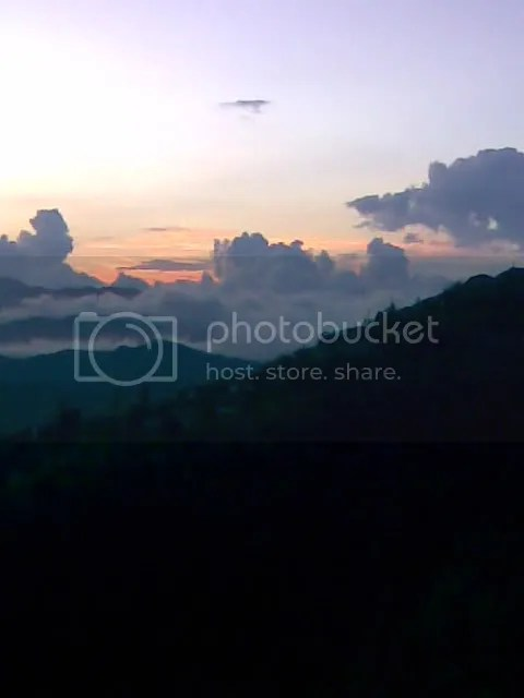 Sunset behind the cloudy mountains