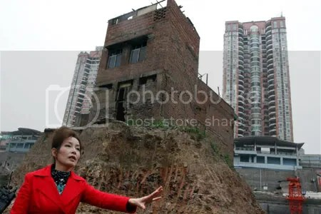 The developers won in the end.  Mrs Wuping demanded that she be given a comparable space in the new development and refused the small payment offered.