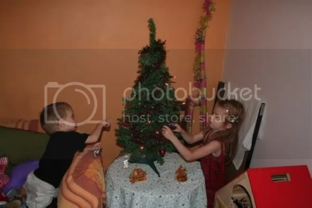 kids helping with  Christmas tree