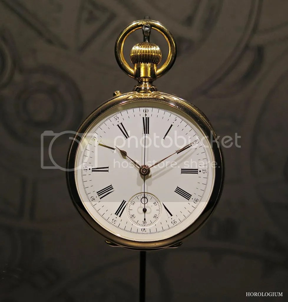 """(1877) Chronograph in 18k gold. Enamel dial, roman numerals, small seconds at 6 o'clock, chronograph pusher on the case band. Calibre RA 19"""" N II chrono."""
