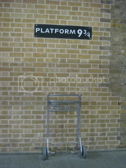 This isn't the original 9 3/4 sign in King Cross Station. They actually shifted it so that tourist won't have to go to the actual platform and disturb everyone else.. the original sign is purple in colour. photo 576780_10151073316671209_588893062_n.jpg