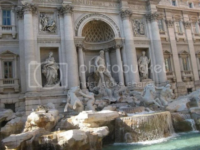 The legendary Trevi Fountain which has been featured in countless movies and films and.. The central figure of the fountain, in front of a large niche, is Neptune, god of the sea. He is riding a chariot in the shape of a shell, pulled by two sea ho photo 315482_10151099484026209_660385089_n.jpg