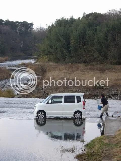 Man washing car in river