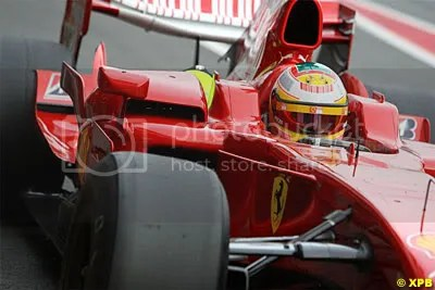 Luca Badoer in a 2008 Ferrari, with slicks and a mock-up KERS.  See the cooling box on the side here.