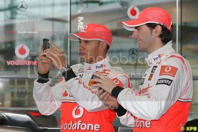 Lewis Hamilton and Pedro de La Rosa messing around for the sponsors