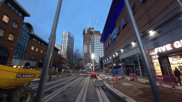 View from the junction with Bishopsgate Street showing Broad Street's new West Midlands Metro tramlines leading towards the Bank Towers (left) and the Moda Living Mercian Tower that will be 42 storeys high on the right once finished. The pavement on the right is going to be noticeably wider than before