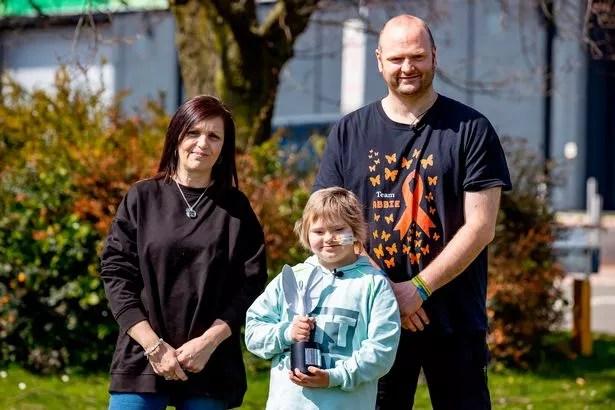 Abbie Bickley with Paul Bickley (dad) and Jackie Bickley (mom)