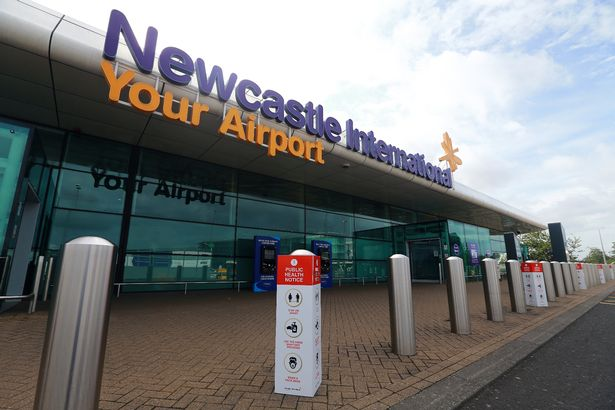 Newcastle Airport: Public health notices are posted outside the terminal.