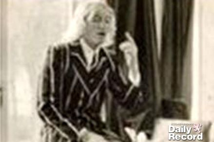 Jimmy Savile photographed in the library at Fort Augustus Catholic school
