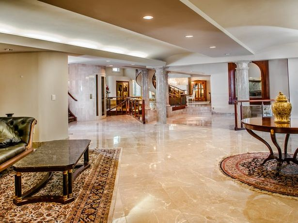The lavish property is stunning throughout with white walls, marble floors and wood panelling