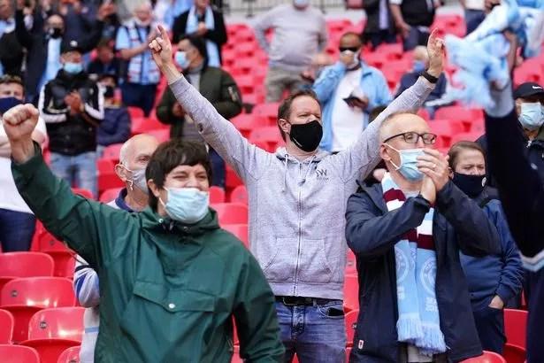 Football fans inside Wembley Stadium for the Carabao Cup Final between Manchester City and Tottenham Hotspur