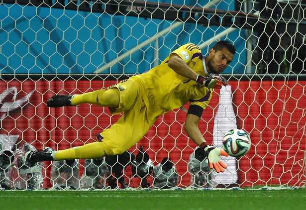 Argentina's goalkeeper Sergio Romero makes a save from Netherlands' defender Ron Vlaar during a penalty shoot out following extra-time in the semi-final football match between Netherlands and Argentina of the FIFA World Cup at The Corinthians Arena in Sao Paulo on July 9, 2014.