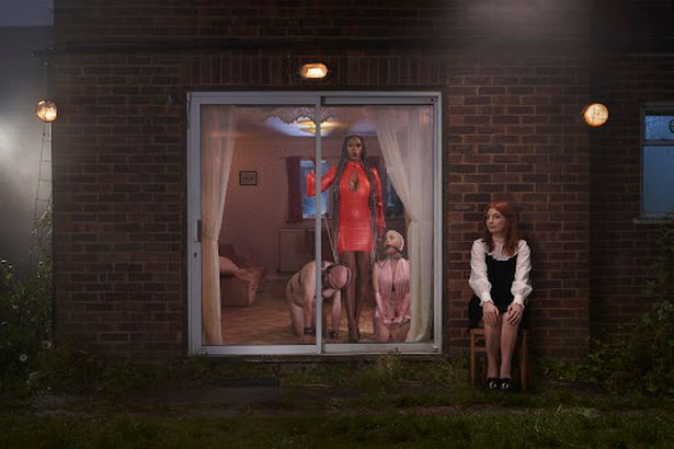 Alice Levine in front of a house - a Channel 4 promotional picture