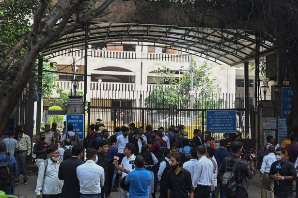 People gathered outside of Rohini Court
