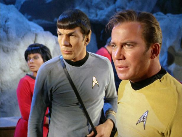 """LOS ANGELES - APRIL 6: From left: Nichelle Nichols as Lt. Nyota Uhura, Leonard Nimoy as Mr. Spock and William Shatner as Captain James T. Kirk in the STAR TREK: THE ORIGINAL SERIES episode, """"The City on the Edge of Forever."""" Original air date, April 6, 1967. Image is a screen grab. (Photo by CBS via Getty Images)"""